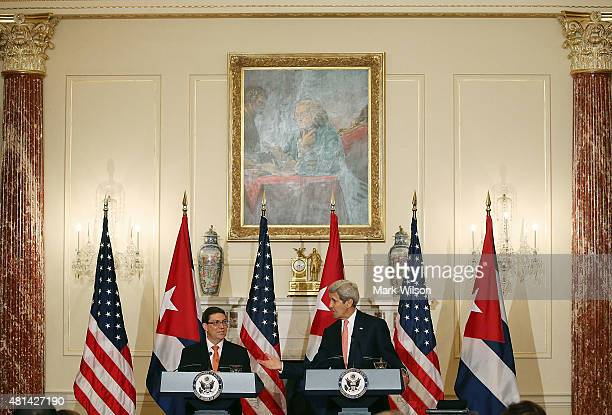 S Secretary of State John Kerry and Cuba's Foreign Minister Bruno Rodriguez speak to the media during a news conference at the State Department July...