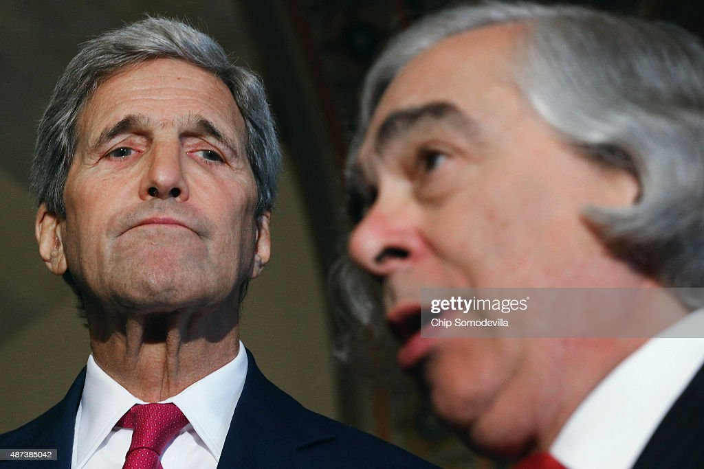 U.S. Secretary of State John Kerry (L) and Energy Secretary Ernest Moniz talk to reporters after meeting with members of Congress at the U.S. Capitol September 9, 2015 in Washington, DC. Moniz and Kerry briefed members of the House and Senate about the Syrian refugee crisis in Europe and the Iran nuclear deal.