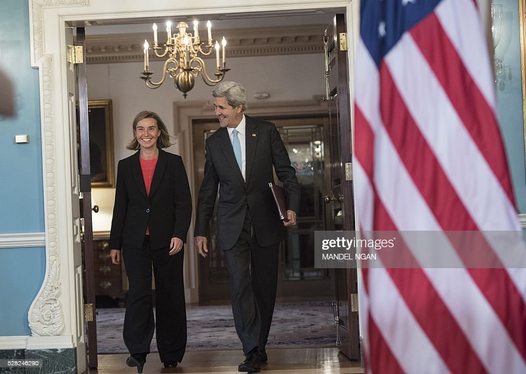 US Secretary of State John Kerry and European Union Foreign Affairs and Security Policy High Representative Federica Mogherini make their way to the Treaty Room to deliver remarks to the press at the State Department on May 4, 2016. / AFP / MANDEL