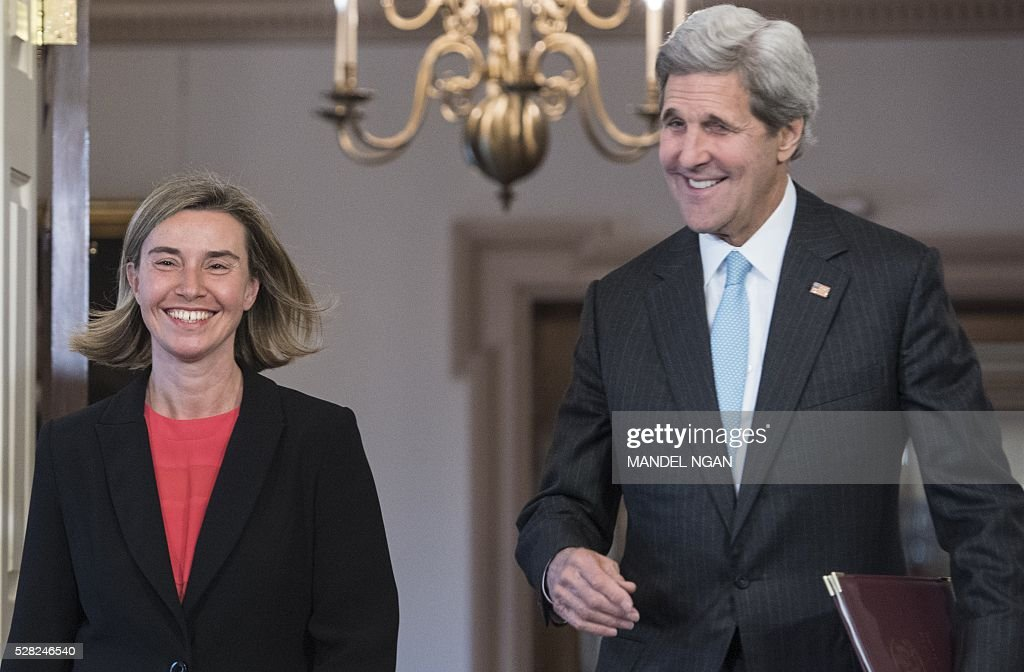 US Secretary of State John Kerry and European Union Foreign Affairs and Security Policy High Representative Federica Mogherini arrive in the Treaty Room to deliver remarks to the press at the State Department on May 4, 2016. / AFP / MANDEL