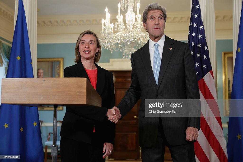U.S. Secretary of State <a gi-track='captionPersonalityLinkClicked' href=/galleries/search?phrase=John+Kerry&family=editorial&specificpeople=154885 ng-click='$event.stopPropagation()'>John Kerry</a> (R) and <a gi-track='captionPersonalityLinkClicked' href=/galleries/search?phrase=Federica+Mogherini&family=editorial&specificpeople=7400570 ng-click='$event.stopPropagation()'>Federica Mogherini</a>, Vice President and High Representative of the European Union for Foreign Affairs and Security Policy, shake hands after talking to reporters the Treaty Room at the State Department May 4, 2016 in Washington, DC. Kerry announced that the United States and Russia have agreed to extend the Syria truce to Aleppo and said that President Bashar al-Assad should start a political transition by August 1 to leave office and end the 5-year-old civil war.