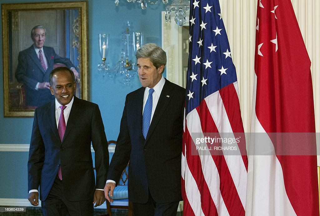 US Secretary of State John Kerry(R) and Foreign Minister of Singapore K. Shanmugam, walk towards the Treaty Room to deliver remarks to the media before their private bilateral meeting March 13, 2013, at the US Department of State in Washington, DC. AFP Photo/Paul J. Richards