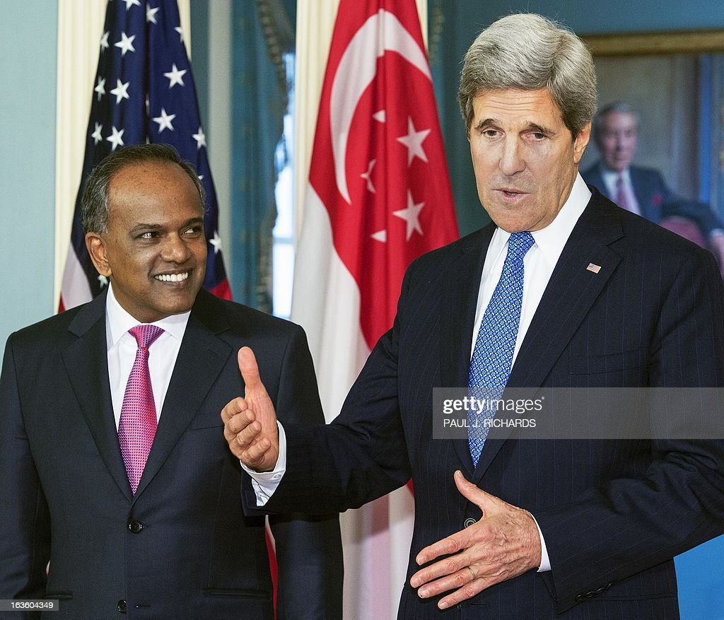 US Secretary of State John Kerry and Foreign Minister of Singapore K. Shanmugam(L), deliver remarks to the media before their private bilateral meeting March 13, 2013, at the US Department of State in Washington, DC. AFP Photo/Paul J. Richards