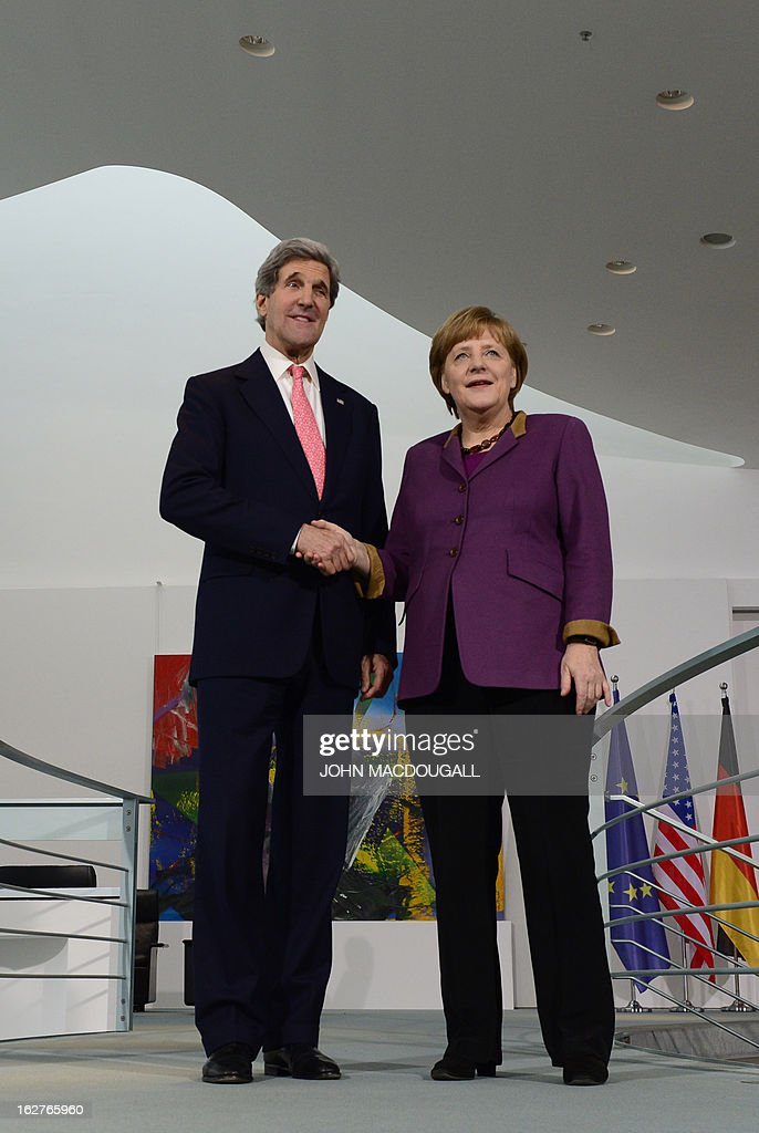 Secretary of State John Kerry and German Chancellor Angela Merkel shake hands after addressing a press conference at the Chancellery in Berlin on February 26, 2013. Kerry visits Berlin as part of a nine-nation tour of US allies in Europe and the Middle East. AFP PHOTO / JOHN MACDOUGALL