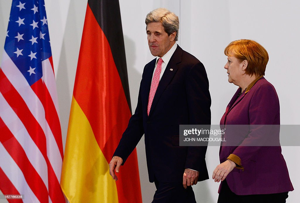 US Secretary of State John Kerry and German Chancellor Angela Merkel (R) arrive to address a press conference at the Chancellery in Berlin on February 26, 2013. Kerry visits Berlin as part of a nine-nation tour of US allies in Europe and the Middle East. AFP PHOTO / JOHN MACDOUGALL