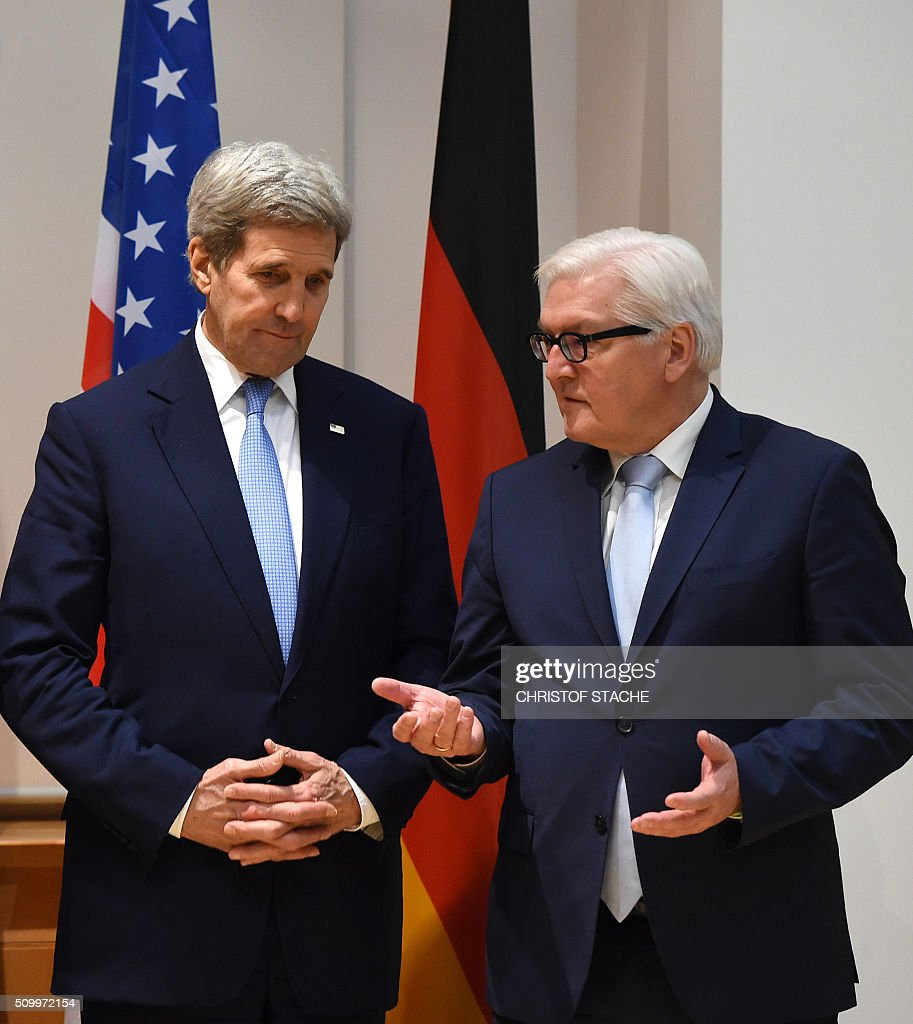 US Secretary of State John Kerry (L) and German Minister for Foreign Affairs Frank-Walter Steinmeier (R) talk together prior the Libya meeting on the sidelines of the second day of the 52nd Munich Security Conference (MSC) in Munich, southern Germany, on February 13, 2016. / AFP / POOL / Christof Stache