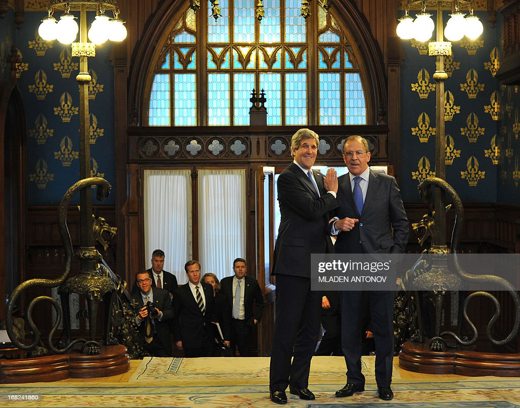 US Secretary of State John Kerry (L) and his Russian counterpart Sergei Lavrov share a joke prior to their talks in the Foreign Ministry Osobnyak in Moscow on May 7, 2013. Kerry arrived today in Moscow for talks with Russian President Vladimir Putin, seeking to restore frayed US-Russia ties and win Moscow's support on the war in Syria. AFP PHOTO/POOL/MLADEN ANTONOV