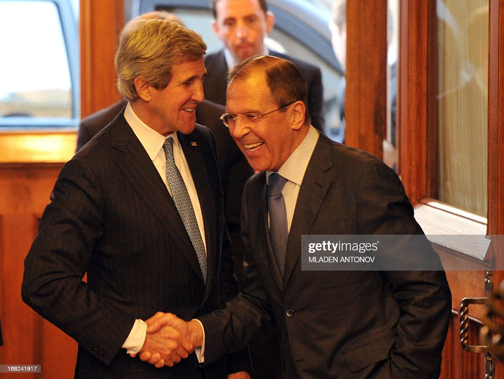 US Secretary of State John Kerry (L) and his Russian counterpart Sergei Lavrov shake hands prior to their talks in the Foreign Ministry Osobnyak in Moscow on May 7, 2013. Kerry arrived today in Moscow for talks with Russian President Vladimir Putin, seeking to restore frayed US-Russia ties and win Moscow's support on the war in Syria. AFP PHOTO/POOL/MLADEN ANTONOV