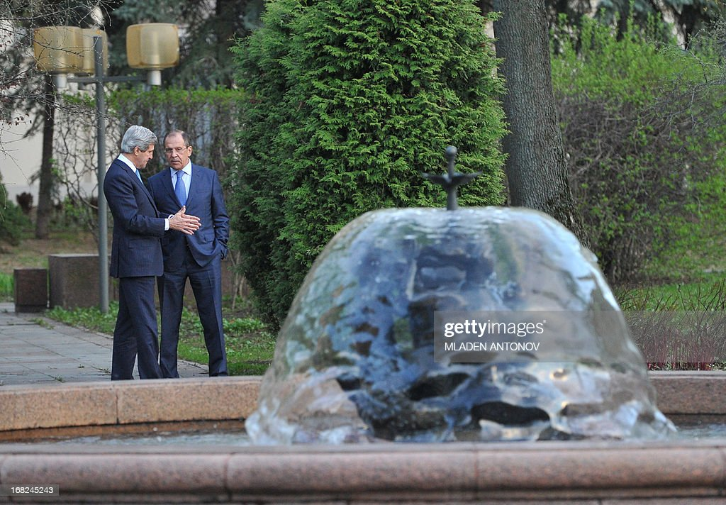 US Secretary of State John Kerry (L) and his Russian counterpart Sergei Lavrov discuss while taking a walk in the garden of the Foreign Ministry Osobnyak in Moscow on May 7, 2013. Kerry arrived today in Moscow for talks with Russian President Vladimir Putin, seeking to restore frayed US-Russia ties and win Moscow's support on the war in Syria.