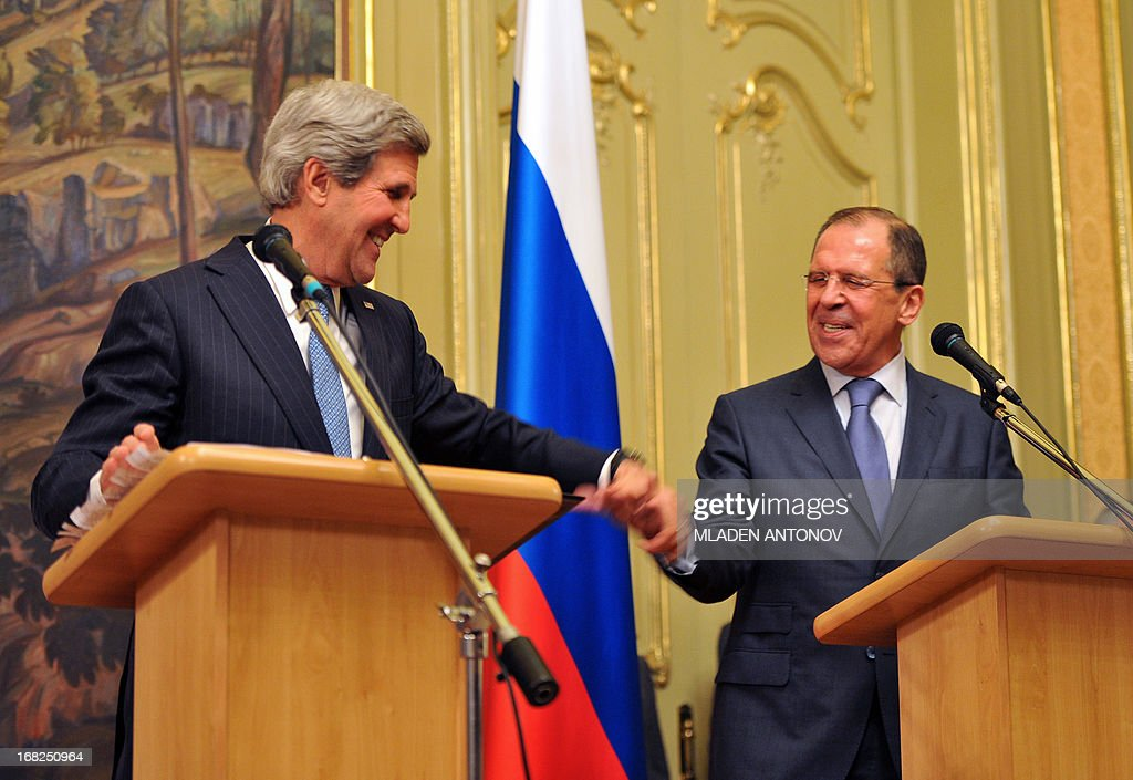 US Secretary of State John Kerry (L) and his Russian counterpart Sergei Lavrov shake hands during a joint press conference following their meeting in Moscow on May 7, 2013. The United States and Russia today agreed to push both warring sides in the Syria conflict to find a negotiated solution and to hold an international conference in search of peace.