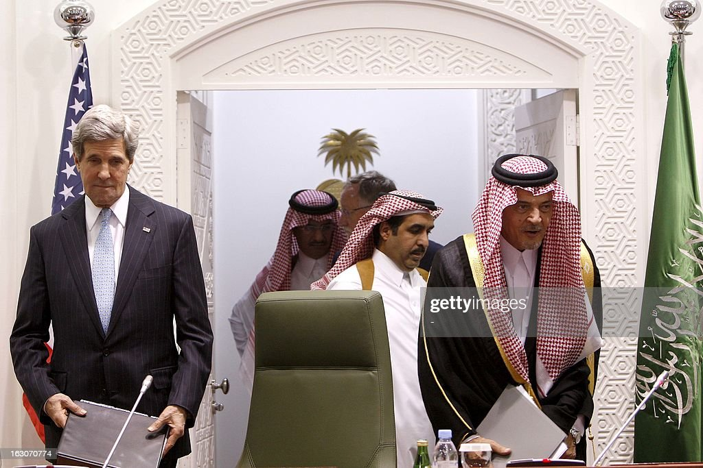 U.S. Secretary of State John Kerry (L) and his Saudi counterpart Prince Saud al-Faisal arrive for a joint press conference at the press hall in the Saudi Foreign Ministry in Riyadh, on March 4, 2013. Saudi Arabia is the seventh leg of Kerry's first official overseas trip. AFP PHOTO/STR