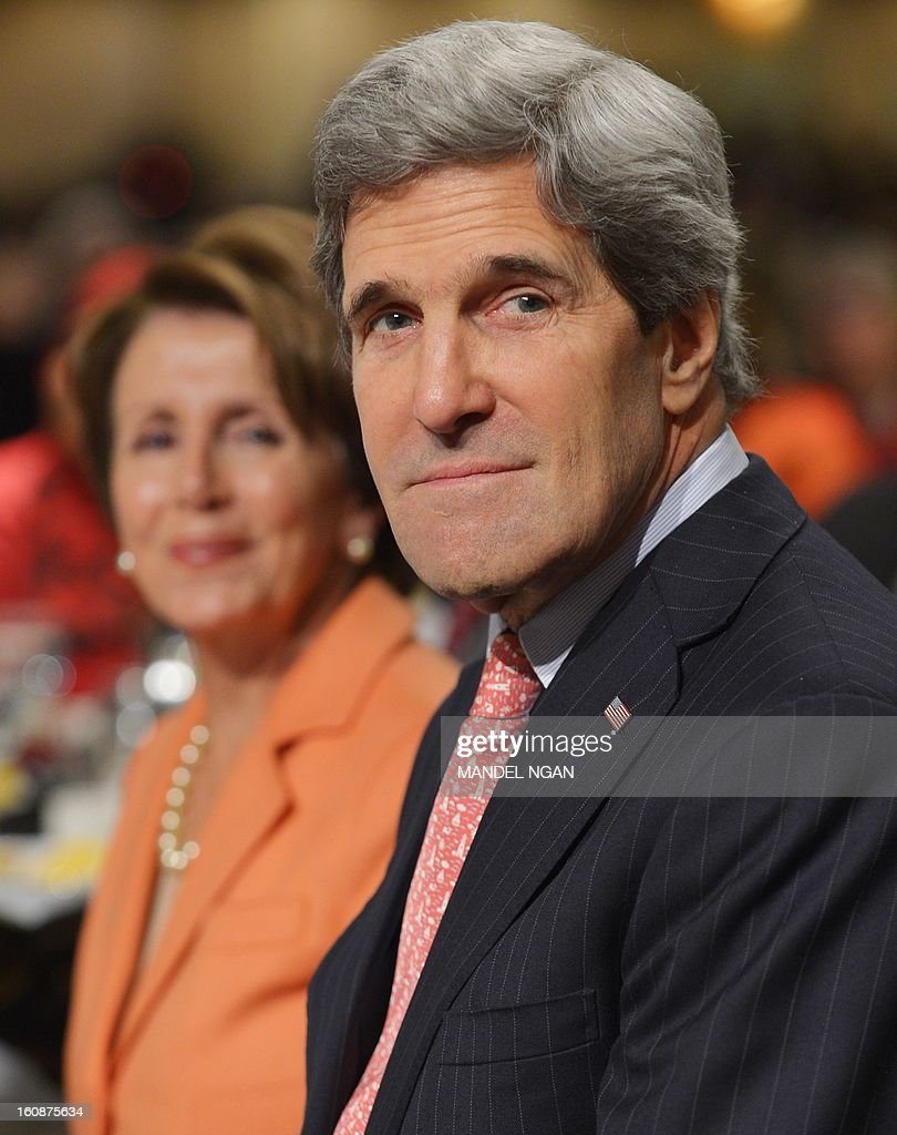 US Secretary of State John Kerry (R) and House Minority Leader Nancy Pelosi (L), D-CA, take part in the National Prayer Breakfast on February 7, 2013 at a hotel in Washington, DC. AFP PHOTO/Mandel NGAN