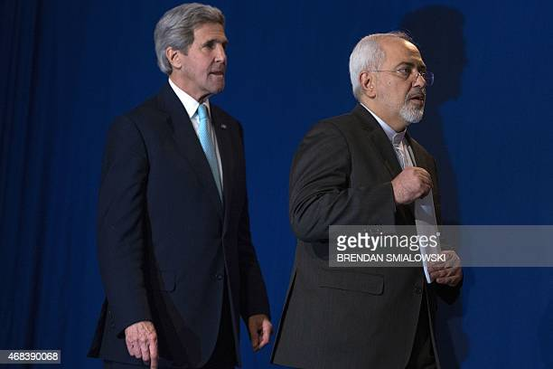 US Secretary of State John Kerry and Iranian Foreign Minister Javad Zarif arrive to deliver a statement at the Swiss Federal Institute of Technology...