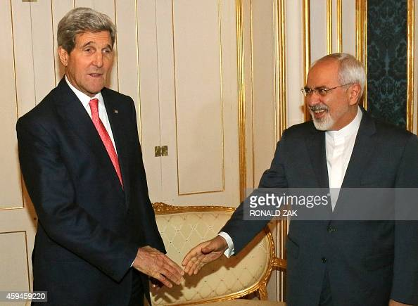 US Secretary of State John Kerry and Iranian Foreign Minister Mohammad Javad Zarif shake hands prior to a bilateral meeting of the closeddoor nuclear...