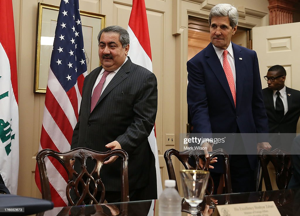 Secretary of State <a gi-track='captionPersonalityLinkClicked' href=/galleries/search?phrase=John+Kerry&family=editorial&specificpeople=154885 ng-click='$event.stopPropagation()'>John Kerry</a> (R) and Iraqi Foreign Minister <a gi-track='captionPersonalityLinkClicked' href=/galleries/search?phrase=Hoshyar+Zebari&family=editorial&specificpeople=227333 ng-click='$event.stopPropagation()'>Hoshyar Zebari</a> arrive for a meeting at the State Department August 15, 2013 in Washington, DC. Secretary Kerry spoke during the U.S.-Iraq Diplomatic and Political Joint Coordinating Committee meeting.