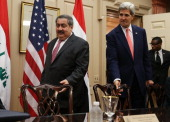 Secretary of State John Kerry and Iraqi Foreign Minister Hoshyar Zebari arrive for a meeting at the State Department August 15 2013 in Washington DC...