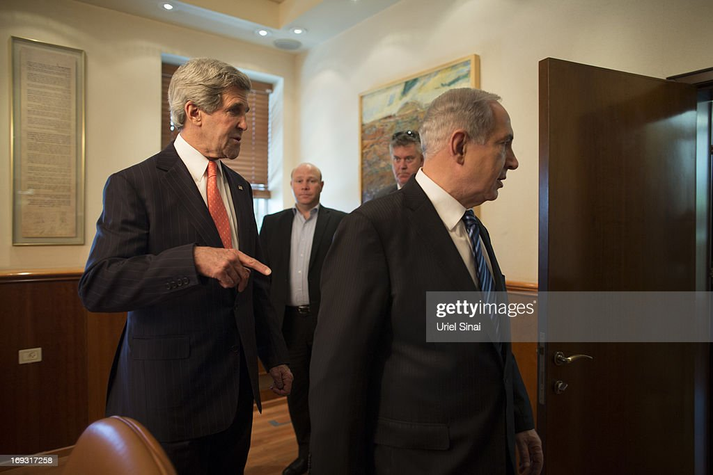 US Secretary of State <a gi-track='captionPersonalityLinkClicked' href=/galleries/search?phrase=John+Kerry&family=editorial&specificpeople=154885 ng-click='$event.stopPropagation()'>John Kerry</a> and Israeli Prime Minister <a gi-track='captionPersonalityLinkClicked' href=/galleries/search?phrase=Benjamin+Netanyahu&family=editorial&specificpeople=118594 ng-click='$event.stopPropagation()'>Benjamin Netanyahu</a> ahead of their meeting on May 23, 2013 in Jerusalem, Israel. This is Kerry's fourth visit to the country in the past two months and British Foreign Secretary William Hague is due to meet him to renew peace talks between Israel and Palestine.