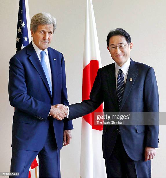 US Secretary of State John Kerry and Japanese Foreign Minister Fumio Kishida shake hands during their bilateral meeting on the sidelines of the G7...