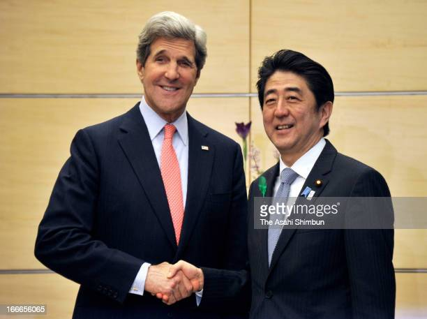 US Secretary of State John Kerry and Japanese Prime Minister Shinzo Abe shake hands prior to their meeting at Abe's official residence on April 15...