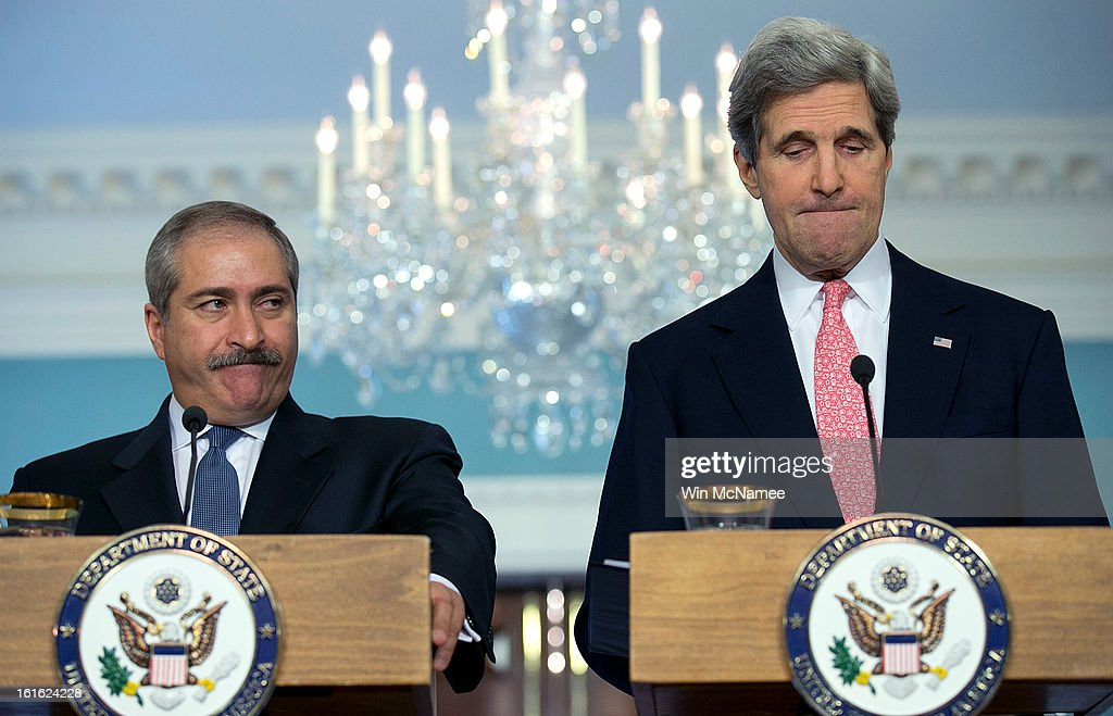U.S. Secretary of State <a gi-track='captionPersonalityLinkClicked' href=/galleries/search?phrase=John+Kerry&family=editorial&specificpeople=154885 ng-click='$event.stopPropagation()'>John Kerry</a> (R) and Jordanian Foreign Minister <a gi-track='captionPersonalityLinkClicked' href=/galleries/search?phrase=Nasser+Judeh&family=editorial&specificpeople=3465453 ng-click='$event.stopPropagation()'>Nasser Judeh</a> answer questions during a joint press conference at the State Department February 13, 2013 in Washington, DC. Kerry and Judeh met privately to discuss efforts in Syria and on the Middle East peace process among other issues.