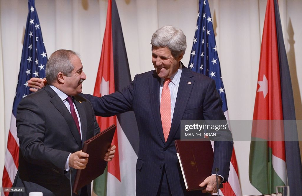 US Secretary of State John Kerry (R) and Jordanian Foreign Minister Nasser Judeh (L) smiles after signing a memorandum of understanding for US assistance to Jordan during a ceremony on February 3, 2015 at a hotel in Washington, DC.