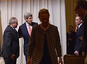 US Secretary of State John Kerry and Jordanian Foreign Minister Nasser Judeh make their way from a room after signing a memorandum of understanding...