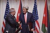 US Secretary of State John Kerry and Jordanian Foreign Minister Nasser Judeh shake hands after signing a memorandum of understanding for US...