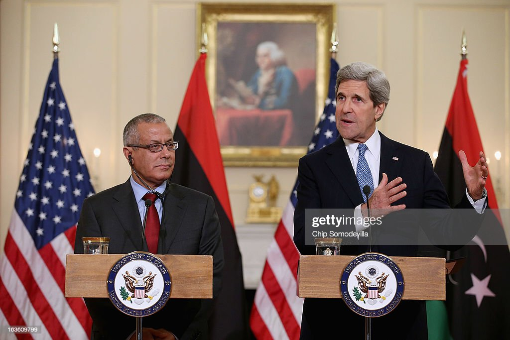 U.S. Secretary of State <a gi-track='captionPersonalityLinkClicked' href=/galleries/search?phrase=John+Kerry&family=editorial&specificpeople=154885 ng-click='$event.stopPropagation()'>John Kerry</a> (R) and Libyan Prime Minister Ali Zeidan hold a news conference in between bilateral meetings in the Ben Franklin Room at the State Department on March 13, 2013 in Washington, DC. The two leaders took time in between meetings to make statements to the news media.