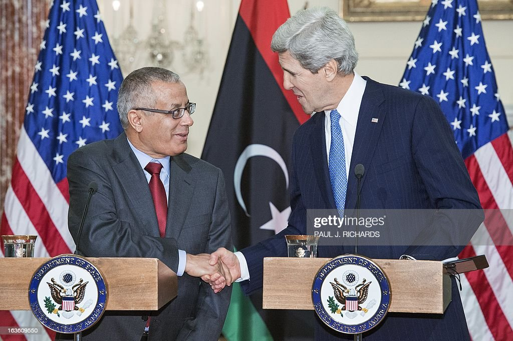 US Secretary of State John Kerry and Libyan Prime Minister Ali Zeidan(L), shake hands after delivering remarks to the media after their private bilateral meeting March 13, 2013, at the US Department of State in Washington, DC. AFP Photo/Paul J. Richards