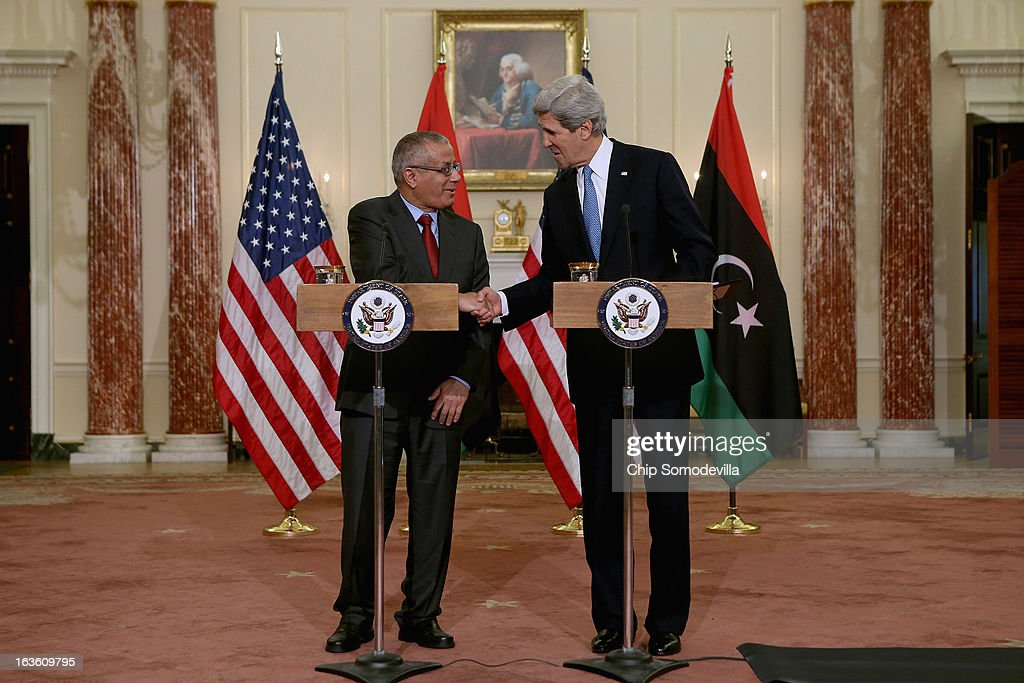 U.S. Secretary of State <a gi-track='captionPersonalityLinkClicked' href=/galleries/search?phrase=John+Kerry&family=editorial&specificpeople=154885 ng-click='$event.stopPropagation()'>John Kerry</a> (R) and Libyan Prime Minister Ali Zeidan shake hands during a news conference in between bilateral meetings in the Ben Franklin Room at the State Department on March 13, 2013 in Washington, DC. The two leaders took time in between meetings to make statements to the news media.