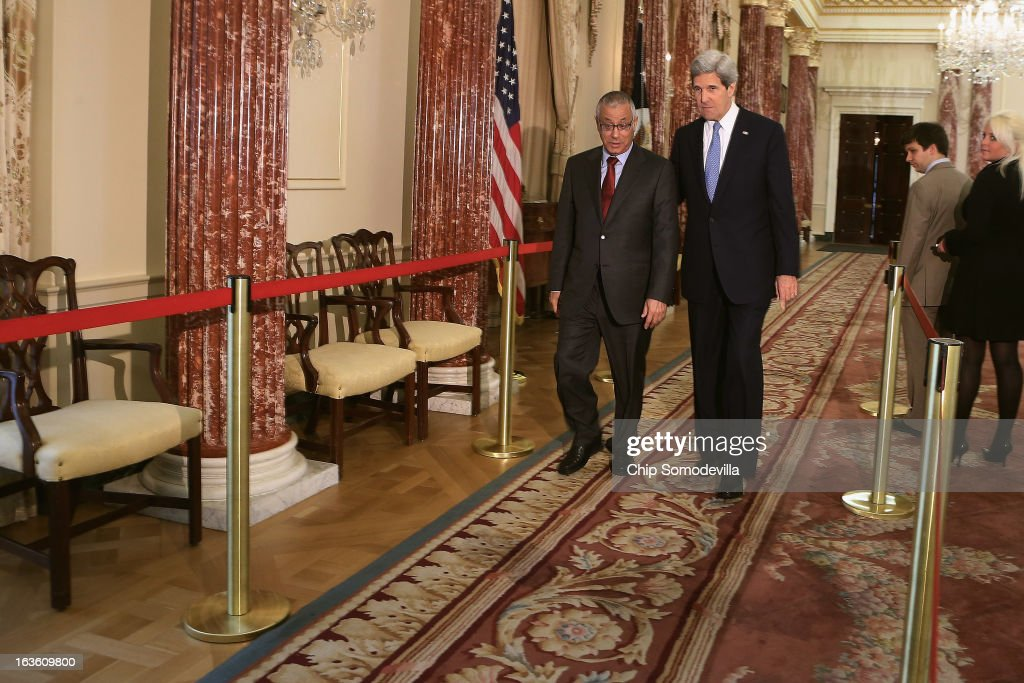 U.S. Secretary of State John Kerry (R) and Libyan Prime Minister Ali Zeidan leave after a news conference during bilateral meetings at the State Department on March 13, 2013 in Washington, DC. The two leaders took time in between meetings to make statements to the news media.