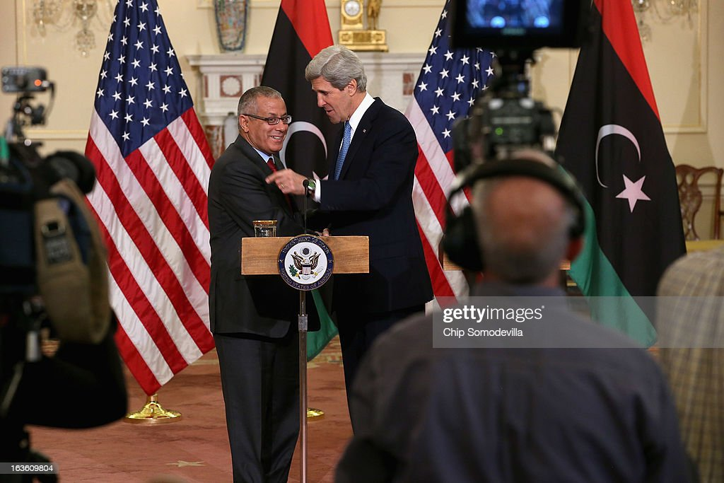 U.S. Secretary of State John Kerry (R) and Libyan Prime Minister Ali Zeidan shake hands after a news conference during bilateral meetings at the State Department on March 13, 2013 in Washington, DC. The two leaders took time in between meetings to make statements to the news media.