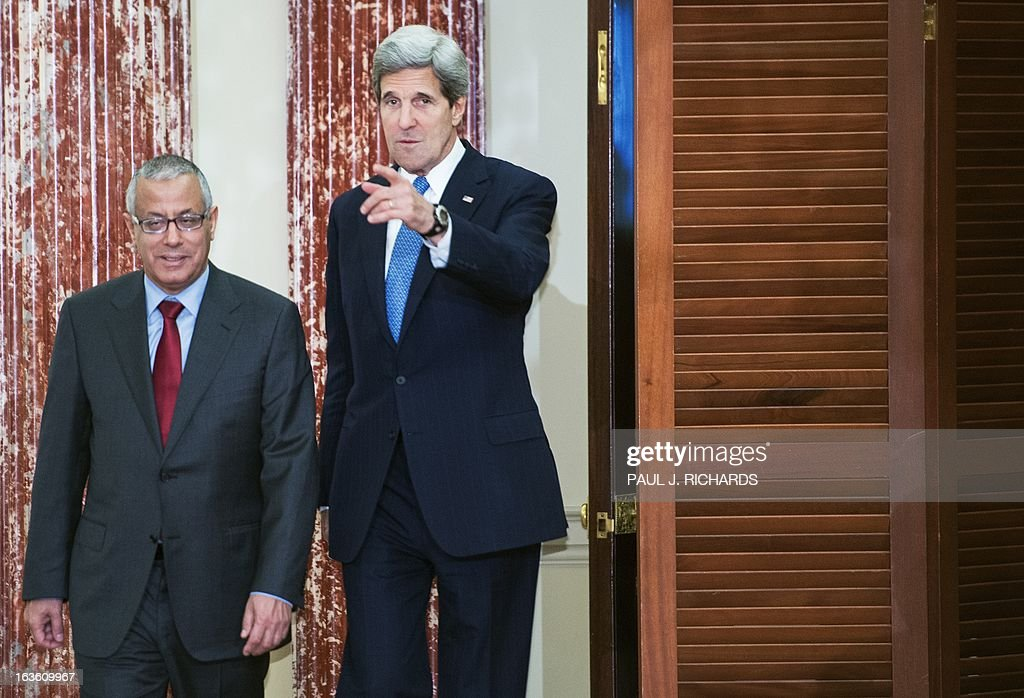US Secretary of State John Kerry and Libyan Prime Minister Ali Zeidan(L), enter the Benjamin Franklin Room to deliver remarks to the media after their private bilateral meeting March 13, 2013, at the US Department of State in Washington, DC. AFP Photo/Paul J. Richards