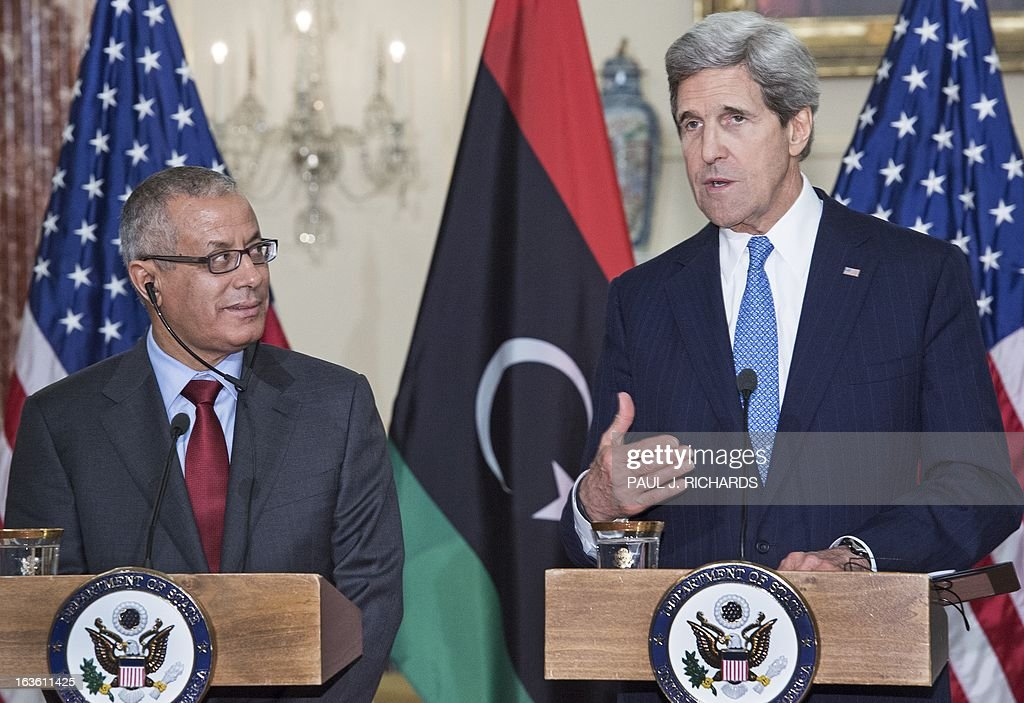 US Secretary of State John Kerry and Libyan Prime Minister Ali Zeidan(L), deliver remarks in the to the media after their private bilateral meeting March 13, 2013, at the US Department of State in Washington, DC. AFP Photo/Paul J. Richards