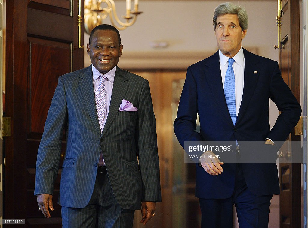 US Secretary of State John Kerry (R) and Nigeria's Foreign Minister Olugbenga Ashiru make their way to speak to the press ahead of a bilateral meeting on April25, 2013 at the State Department in Washington, DC. AFP PHOTO/Mandel NGAN
