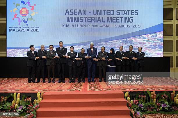 US Secretary of State John Kerry and representatives of ASEAN pose for a group portrait before a USASEAN Ministerial Meeting at the Putra World Trade...