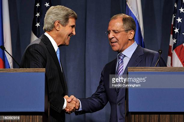 Secretary of State John Kerry and Russian Foreign Minister Sergey Lavrov shake hands as they speak to the press at the Hotel Intercontinental on...