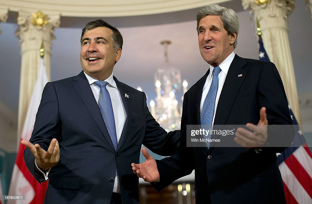U.S. Secretary of State John Kerry (R) and the President of Georgia Mikheil Saakashvili speak to journalists following a bilateral meeting at the U.S. State Department May 1, 2013 in Washington, DC. Kerry is scheduled to travel to Russia next week to discuss recent developments in the region.