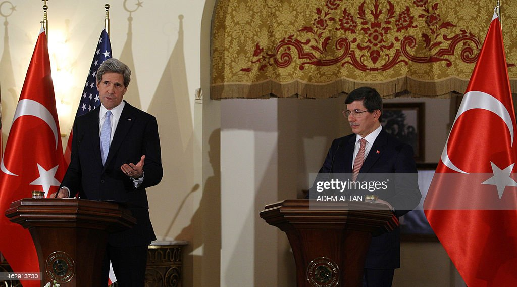 U.S. Secretary of State John Kerry (L) and Turkey's Foreign Affairs minister Ahmet Davutoglu give a press conference in Ankara on March 1, 2013. John Kerry held talks with Turkey's leaders on the Syria crisis today amid a row over controversial comments by Prime Minister Recep Tayyip Erdogan branding Zionism a 'crime against humanity'. AFP PHOTO ADEM ALTAN