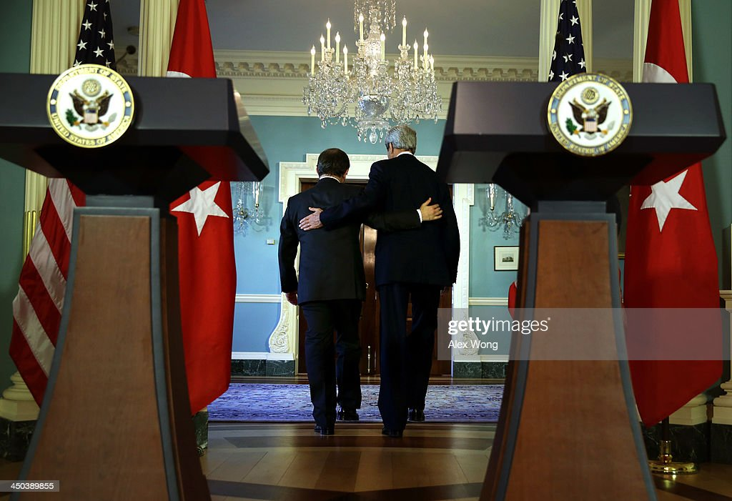 U.S. Secretary of State <a gi-track='captionPersonalityLinkClicked' href=/galleries/search?phrase=John+Kerry&family=editorial&specificpeople=154885 ng-click='$event.stopPropagation()'>John Kerry</a> (R) and Turkish Foreign Minister <a gi-track='captionPersonalityLinkClicked' href=/galleries/search?phrase=Ahmet+Davutoglu&family=editorial&specificpeople=4940018 ng-click='$event.stopPropagation()'>Ahmet Davutoglu</a> (L) leave after a joint press availability November 18, 2013 at the State Department in Washington, DC. Davtoglu was on a two-day visit in Washington to discuss bilateral issues and regional developments with U.S. officials.