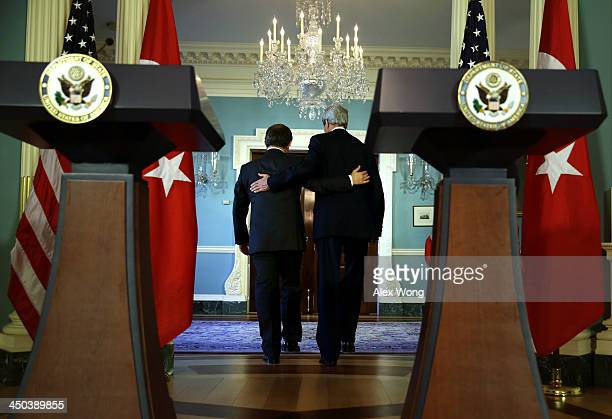 S Secretary of State John Kerry and Turkish Foreign Minister Ahmet Davutoglu leave after a joint press availability November 18 2013 at the State...