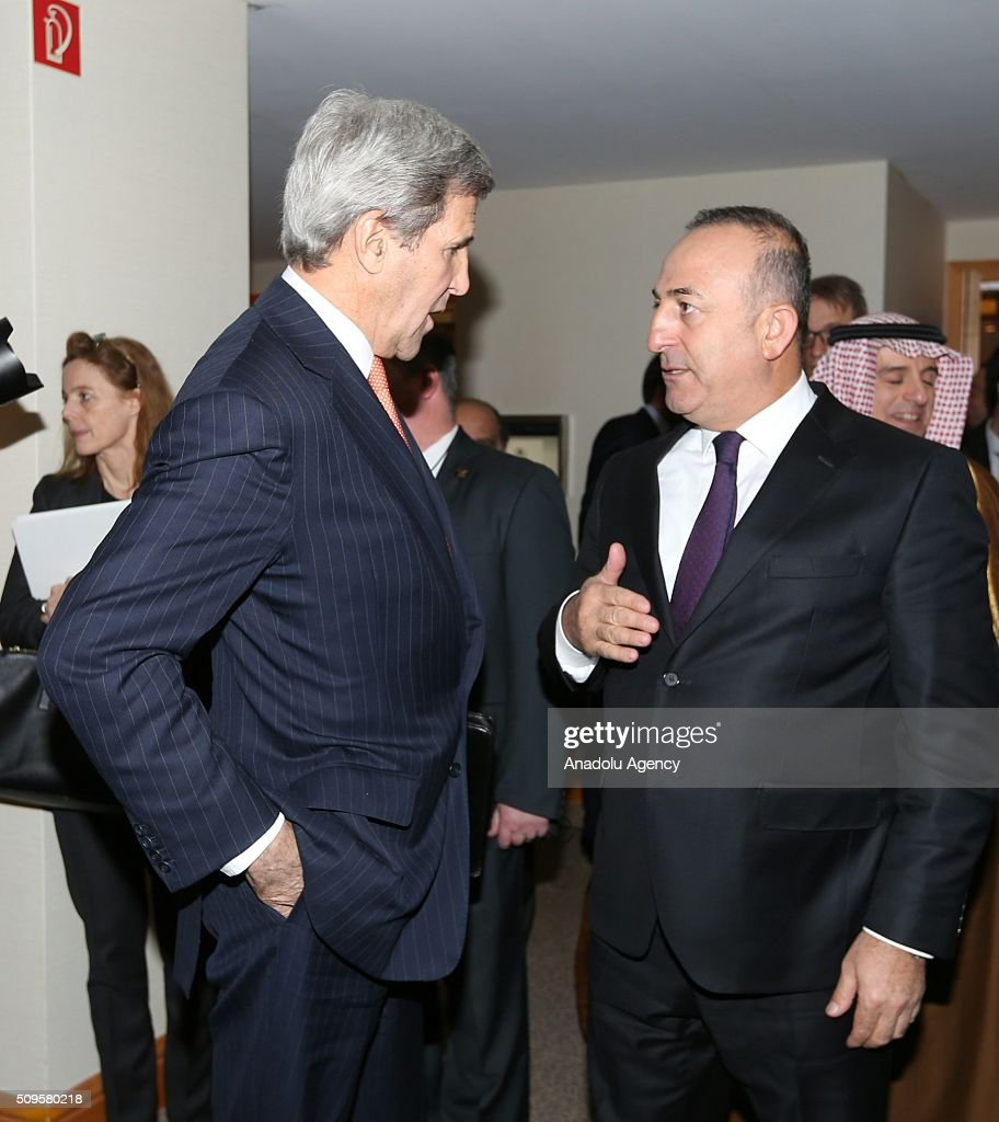 US Secretary of State John Kerry (L) and Turkish Foreign Minister Mevlut Cavusoglu (R) are seen after an International Syrian Support Group Meeting in Munich, Germany on February 11, 2016.