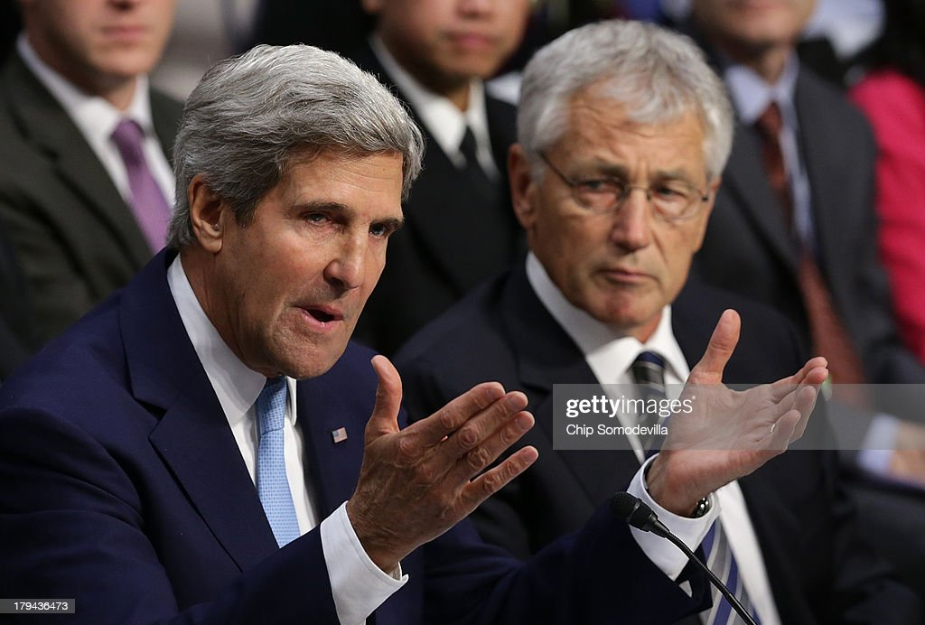 U.S. Secretary of State <a gi-track='captionPersonalityLinkClicked' href=/galleries/search?phrase=John+Kerry&family=editorial&specificpeople=154885 ng-click='$event.stopPropagation()'>John Kerry</a> (L) and U.S. Defense Secretary <a gi-track='captionPersonalityLinkClicked' href=/galleries/search?phrase=Chuck+Hagel&family=editorial&specificpeople=504963 ng-click='$event.stopPropagation()'>Chuck Hagel</a> (R) testify before the Senate Foreign Relations Committee on the topic of 'The Authorization of Use of Force in Syria' September 3, 2013 in Washington, DC. U.S. President Barack Obama is attempting to enlist the support of members of the U.S. Congress for military action against the Syrian government for using chemical weapons against its own people last month.