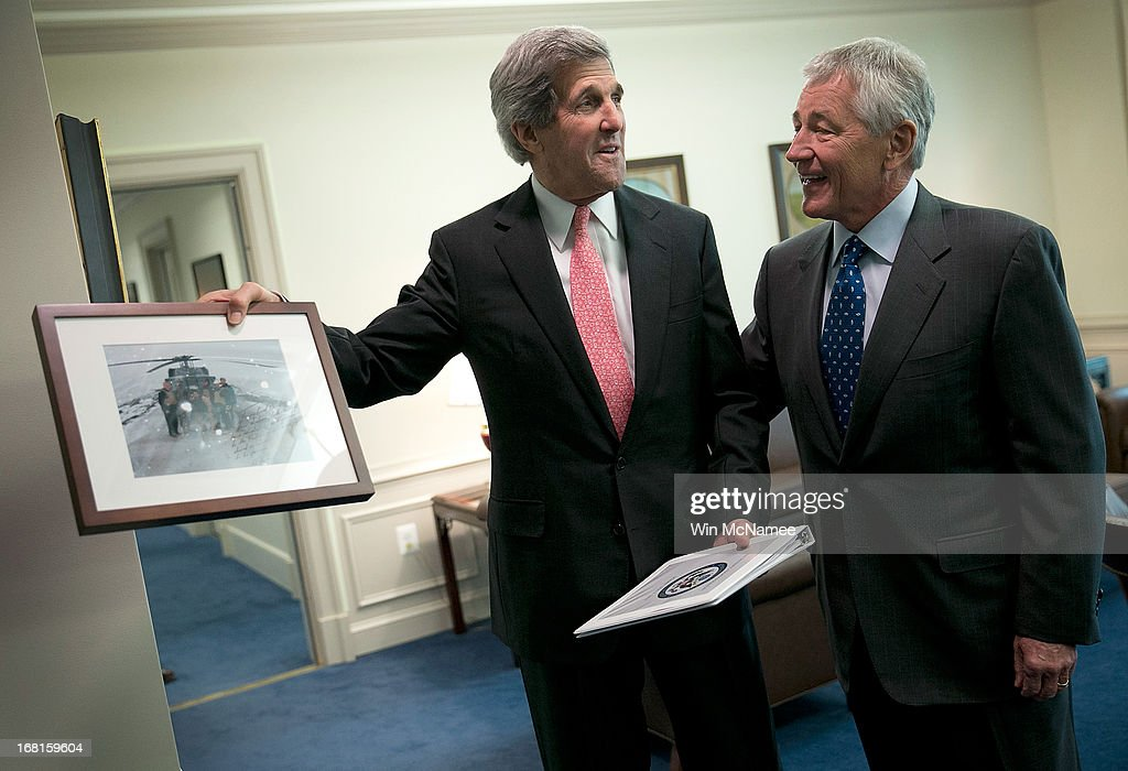 U.S. Secretary of State <a gi-track='captionPersonalityLinkClicked' href=/galleries/search?phrase=John+Kerry&family=editorial&specificpeople=154885 ng-click='$event.stopPropagation()'>John Kerry</a> (L) and U.S. Secretary of Defense <a gi-track='captionPersonalityLinkClicked' href=/galleries/search?phrase=Chuck+Hagel&family=editorial&specificpeople=504963 ng-click='$event.stopPropagation()'>Chuck Hagel</a> (R) discuss a gift Kerry brought for Hagel prior to a meeting in Hagel's office at the Pentagon May 6, 2013 in Arlington, Virginia. Kerry and Hagel met for a working lunch to discuss a range of national security issues.