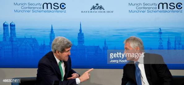 Secretary of State John Kerry and US Secretary of Defense Chuck Hagel talk during the 50th Munich Security Conference at the Bayerischer Hof hotel on...