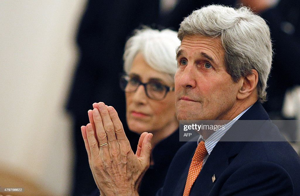 U.S. Secretary of State John Kerry (R) and U.S. Under Secretary for Political Affairs Wendy Sherman (L) meet with foreign ministers of Germany, France, ... - secretary-of-state-john-kerry-and-us-under-secretary-for-political-picture-id479756622