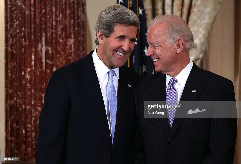 U.S. Secretary of State <a gi-track='captionPersonalityLinkClicked' href=/galleries/search?phrase=John+Kerry&family=editorial&specificpeople=154885 ng-click='$event.stopPropagation()'>John Kerry</a> (L) and Vice President Joseph (R) share a moment during Kerry's ceremonial swearing in at the State Department February 6, 2013 in Washington, DC. Kerry was officially sworn in on February 1 at the U.S. Capitol as the 68th Secretary of State, succeeding Hillary Clinton.