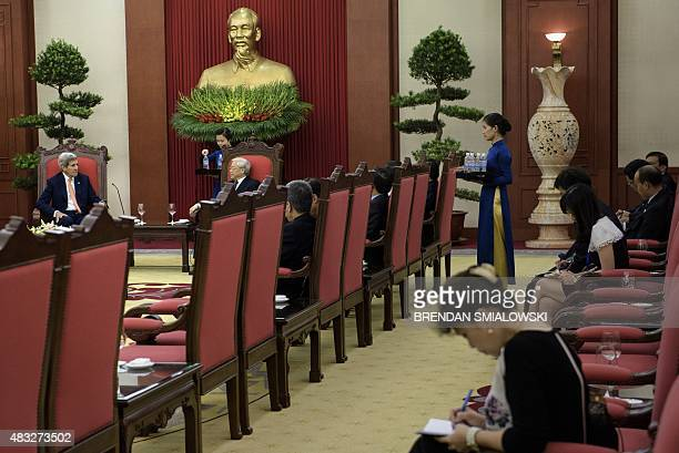 US Secretary of State John Kerry and Vietnams General Secretary Nguyen Phu Trong speak before a meeting in Hanoi on August 7 2015 Kerry on August 7...