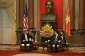 US Secretary of State John Kerry and Vietnam's President Truong Tan Sang wait for a meeting at the Presidential Palace in Hanoi on August 7 2015 AFP...