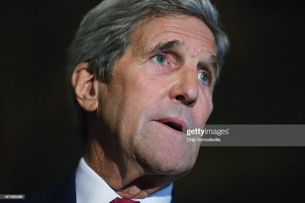 U.S. Secretary of State John Kerry answers reporters' questions after meeting with members of Congress at the U.S. Capitol September 9, 2015 in Washington, DC. Joined by Energy Secretary Ernest Moniz, Kerry briefed members of the House and Senate about the Syrian refugee crisis in Europe and the Iran nuclear deal.